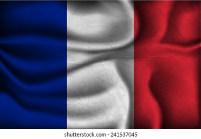 crumpled flag of France on a light background.