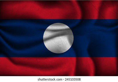 crumpled flag of Laos on a light background.