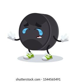 crying cartoon black rubber hockey puck mascot on white background