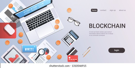 crypto currency block chain concept bitcoin mining workplace desk top angle view tablet laptop computer paper documents report finance graph flat copy space horizontal