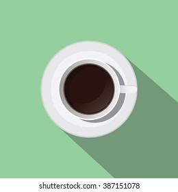 a cup of black coffee from top flat with long shadow