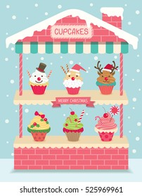 Cupcakes christmas put at  house shelf on snow background.