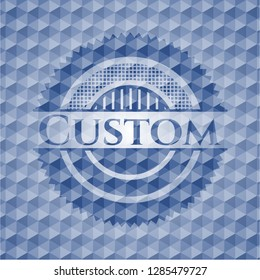 Custom blue emblem with geometric background.