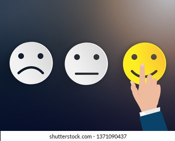 Customer service evaluation and satisfaction survey concepts. Hand of the businessman touching picked the happy face smile.
