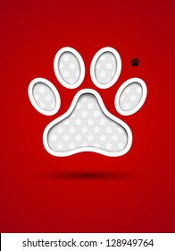 Cut out red card with animal footprint