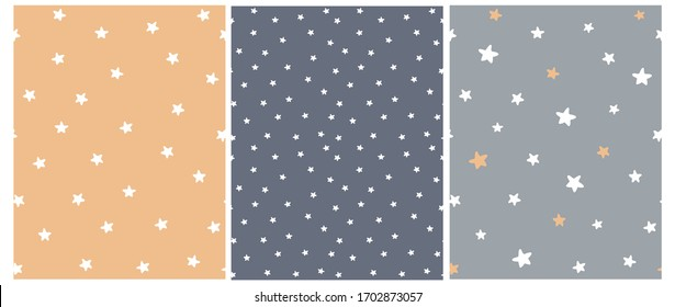 Cute Abstract Starry Sky Seamless Vector Patterns. White Freehand Stars on a Gray, Graphite and Pale Orange Background. Simple Infantile Style Irregular Print with Funny Hand Drawn Stars.