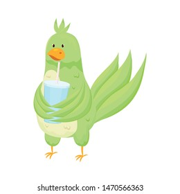 Cute adorable green parrot drink fresh soda in glass
