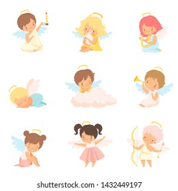 Cute Baby Angels with Nimbus and Wings Set, Adorable Boys And Girls Cartoon Characters in Angel Costumes Vector Illustration