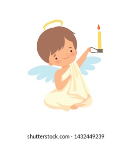 Cute Boy Angel with Nimbus and Wings Sitting and Holding Burning Candle, Lovely Baby Cartoon Character in Cupid or Cherub Costume Vector Illustration