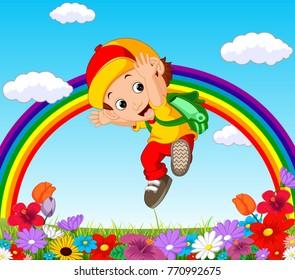 Cute boy in a flower garden with rainbow
