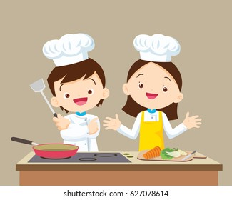 Cute Boy and Girl cooking in the kitchen. little chef presenting.