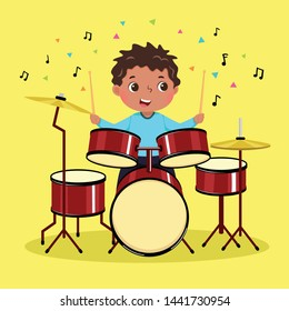 Cute boy playing the drum on yellow background