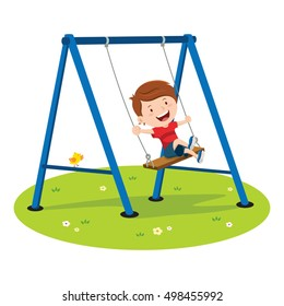 Cute boy playing on swing