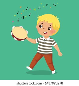 Cute boy playing tambourine on green background