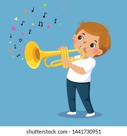 Cute boy playing the trumpet on blue background