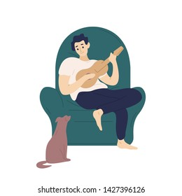 Cute boy sitting in comfy armchair and playing ukulele for his dog. Funny adorable musician with guitar and his domestic animal. Young man relaxing at home. Flat cartoon colorful vector illustration.