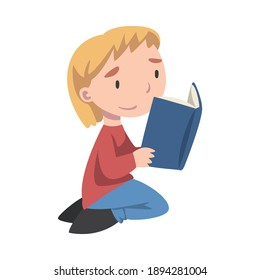 Cute Boy Sitting On Floor on his Knees and Reading Book, Adorable Kid Enjoying of Literature, Elementary School Student Character Cartoon Style Vector Illustration