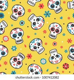 Cute bright vector seamless pattern with skulls and flowers on yellow