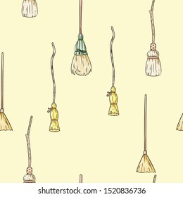 Cute broomstick doodles seamless pattern. Halloween decoration magic brooms background tile