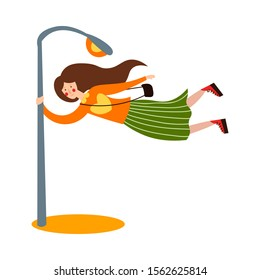 Cute brown-haired girl blows by the wind. She holds on to a pole. Vector illustration in flat cartoon style.