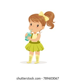 Cute brown-haired girl drinking her refreshing cocktail. Cartoon kid character in t-shirt with bunny print and green skirt with suspenders. Flat vector design