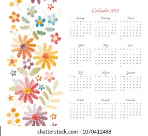 Cute calendar for 2019 year. Week starts on sunday. Vector template with floral ornament of colorful embroidered flowers.  Ethnic embroidery pattern.