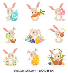 Cute cartoon bunnies holding colored eggs set, funny rabbit characters, Happy Easter concept cartoon vector Illustrations
