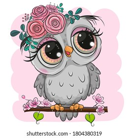 Cute Cartoon Owl with flowers is sitting on a branch