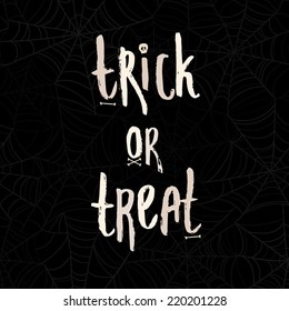 """Cute cartoon words """"Trick or treat"""" with bones and scull on spider web seamless pattern"""