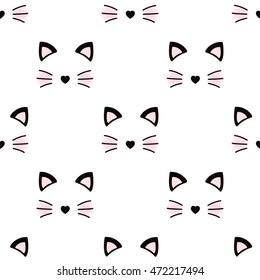 Cute cat face. Seamless wallpaper