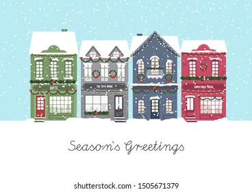 Cute Christmas houses. Winter village. Decorated Houses town. Season`s Greetings. Vector