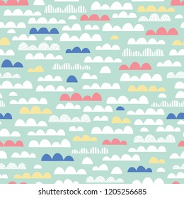 Cute Clouds Nursery Vector Seamless Pattern. Pink, Yellow, Blue and White Clouds on Mint Background. Baby Kids Print