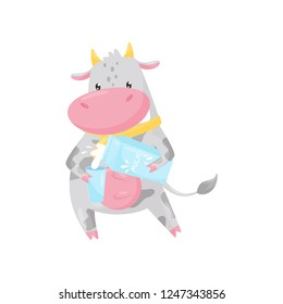 Cute cow pouring milk into a glass, funny farm animal cartoon character vector Illustration on a white background