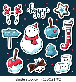 Cute doodle hygge stickers. Vector hand drawn stickers with hygge lettering and cozy things: snowman, deer antlers, marshmallows, apple in caramel, stocking, north pole sign, cinnamon, christmas tree.
