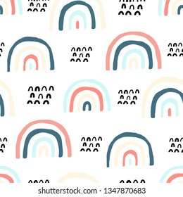 Cute doodle vector pattern with rainbows and clouds. Summer design.