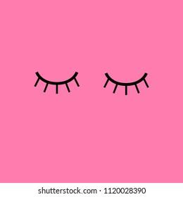 Cute eyelashes on pink background