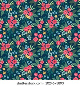 """Cute Floral pattern in the small flower. """"Ditsy print"""". Motifs scattered random. Seamless texture. Elegant template for fashion prints. Printing with small colorful flowers. Dark blue background."""