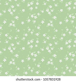 Cute floral pattern in the small flower. Ditsy print. Motifs scattered random. Seamless vector texture. Elegant template for fashion prints. Printing with small white flowers. Blue background.
