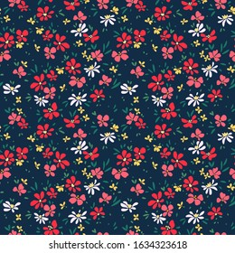 Cute floral pattern in the small flower. Ditsy print. Seamless vector texture. Elegant template for fashion prints. Printing with small red, pink and yellow flowers. Dark blue background.