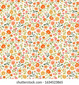 Cute floral pattern in the small flower. Ditsy print. Seamless vector texture. Elegant template for fashion prints. Printing with small orange flowers. White background.