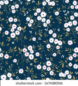 Cute floral pattern in the small flowers. Ditsy print. Seamless vector texture. Elegant template for fashion prints. Printing with small white flowers. Dark blue background.