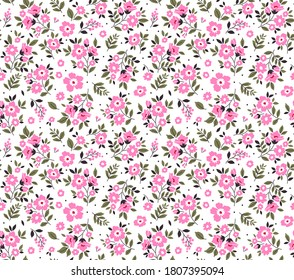 Cute floral pattern in the small flowers. Seamless vector texture. Elegant template for fashion prints. Printing with small pink flowers. White background.