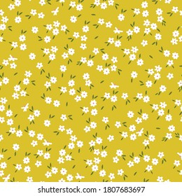 Cute flower pattern in a small flower. Elegant template for fashionable prints. Print small white flowers on a yellow background.