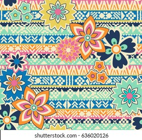 cute flowers over tribal seamless background