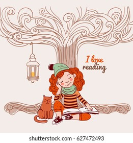 Cute, funny girl reads a book under the tree