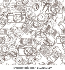 Cute and funny vintage hand drawn photo cameras seamless pattern vector