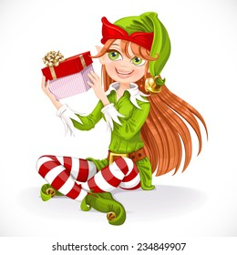 Cute girl Santa elf sit on floor hold gift  isolated on a white background