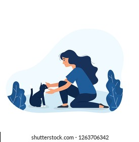 cute girl take care of stray cat on the street, young girl sitting and touch domestic cat outdoor, adorable cat and young girl