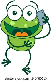 Cute green frog with bulging eyes and long legs while talking on a smartphone with great enthusiasm