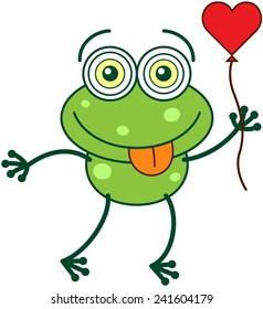 Cute green frog with bulging funny eyes and long legs while sticking its tongue out, holding a red heart balloon with its hand and feeling madly in love